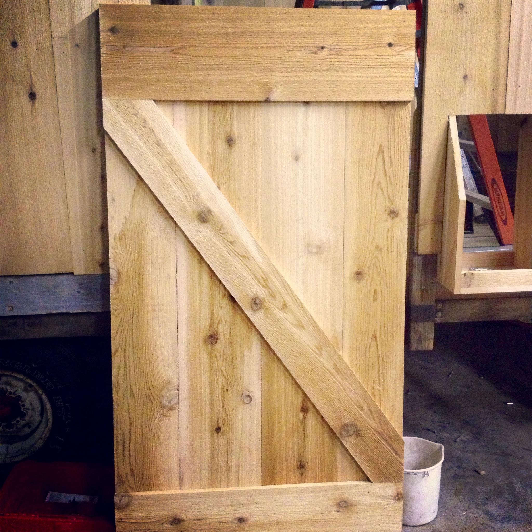 Building a sliding barn door mauledbydesign for Sliding barn door construction plans